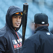 NEW YORK, NEW YORK - APRIL 12: Hitting coach Barry Bonds, Miami Marlins, talking with Giancarlo Stanton, (left),  at batting practice before the Miami Marlins Vs New York Mets MLB regular season ball game at Citi Field on April 12, 2016 in New York City. (Photo by Tim Clayton/Corbis via Getty Images)