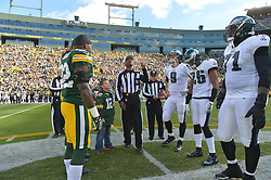 GREEN BAY, WI - NOVEMBER 10: The Green Bay Packers and Philadelphia Eagles watch the coin toss at Lambeau Field on November 10, 2013 in Green Bay, Wisconsin. (Photo by Drew Hallowell/Philadelphia Eagles/Getty Images) *** Local Caption ***