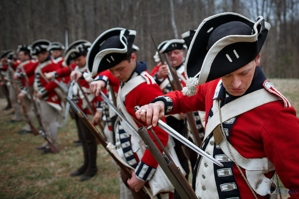 Members of the 7th Regiment of Foot (Royal Fusiliers) return their bayonets during a drill as they prepare for battle.<br /> <br /> Over 300 Revolutionary War reenactors from across the country mustered in Greensboro on March 12 &13 for the Battle of Guilford Courthouse, which originally occurred on March 15, 1781. The reenactment attracts hundreds of participants and thousands of onlookers to see a live recreation of the original battle and life in the combatants camps. American and British troops fire on each other with cannons and flintlock muskets as they advance toward each other on the rolling fields of Country Park in Greensboro, NC, the county seat of Guilford County. During the American Revolutionary War a 2,100-man British force under the command of Lieutenant General Charles Cornwallis defeated Major General Nathanael Greene's 4,500 Americans. The British Army, however, lost a considerable number of men during the battle with estimates as high as 27%. Such heavy British casualties resulted in a strategic victory for the Americans.<br /> <br /> JERRY WOLFORD / Perfecta Visuals