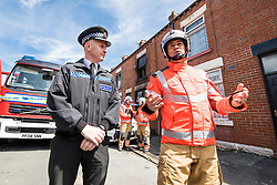 © Licensed to London News Pictures . 08/07/2017 . Bolton , UK . Superintendent STEVE KEELEY for Greater Manchester Police and Assistant County Fire Officer TONY HUNTER for Greater Manchester Fire and Rescue at a press conference in front of the house . Scene on Rosamond Street in Daubhill , where a fatal house fire burned through a mid-terrace house this morning (Saturday 8th July 2017) . Firefighters responded at 9am this morning (Saturday 8th July 2017) . A family of five are reported to have been inside at the time and there are understand to me multiple fatalities . Photo credit : Joel Goodman/LNP