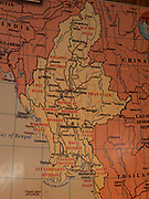 Map of Myanmar on the wall of a restaurant showing the major cities and regions