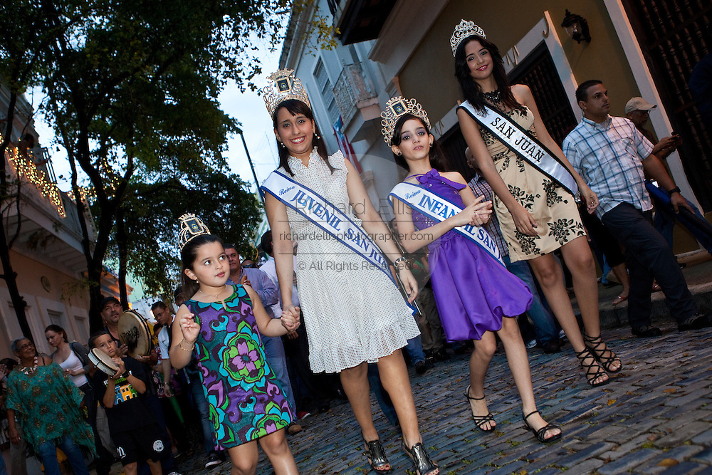 San Juan beauty contest winners march in a parade through the streets of Old San Juan January 13, 2011 during the Festival of San Sebastian in San Juan, Puerto Rico.