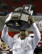 ATLANTA, GA - DECEMBER 31:  Texas A&M Aggies head coach Kevin Sumlin holds up the championship trophy after the Chick-fil-A Bowl game against the Duke Blue Devils at the Georgia Dome on December 31, 2013 in Atlanta, Georgia.  (Photo by Mike Zarrilli/Getty Images)