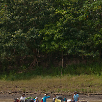 A dangerously-laden boat carries passengers and cargo on the Amazon River near Iquitos, Peru.