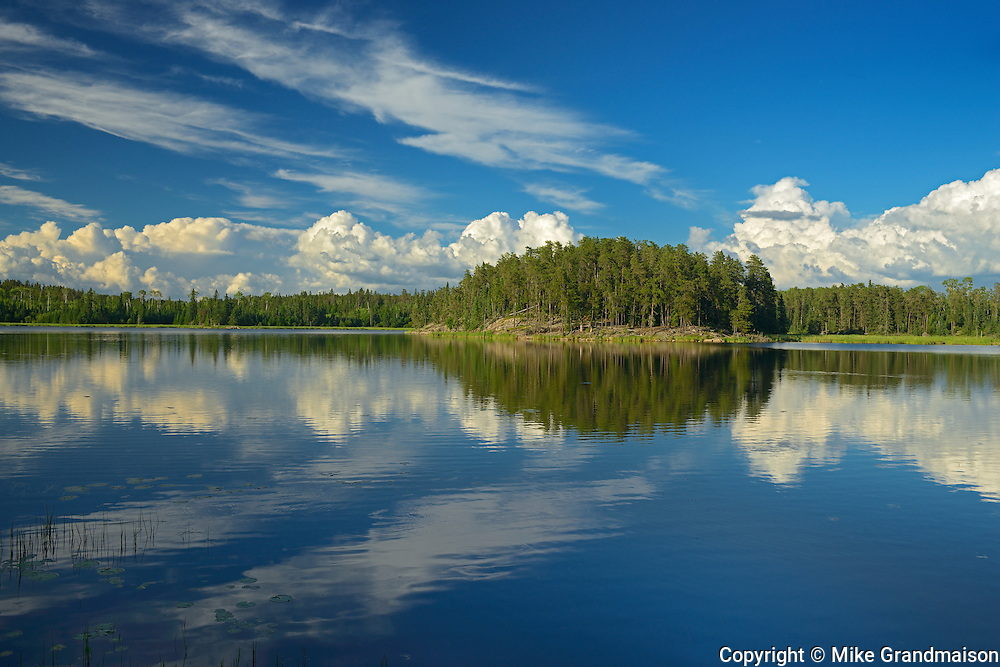 Clouds reflected in Isabel Lake<br /> Kenora<br /> Ontario<br /> Canada