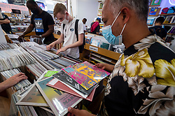 © Licensed to London News Pictures. 12/06/2021. LONDON, UK. A customer shows his purchases in Sounds of the Universe Records in Soho on Record Store Day, where independent record shops worldwide celebrate music, including special vinyl releases made exclusively for the day. In the UK, vinyl sales have increased for the 13th consecutive year.  The BPI reported that nearly 5m records were sold in the 2020 in the UK as, with more time spent at home, music lovers had time to add to their collections.  Photo credit: Stephen Chung/LNP
