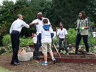 """President Barack Obama gives Olanzo Mourning an """"arm bump"""" as he  joins  First Lady Michelle Obama as the first lady dedicates White House Kitchen Garden and Highlights Impact of Let's Move! on Healthy Living.Photo by  Dennis Brack"""