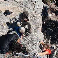 National Geographic photography seminar documents rock climbing on Rundle Rock near town of Banff in Alberta's Banff National Park, Canada.