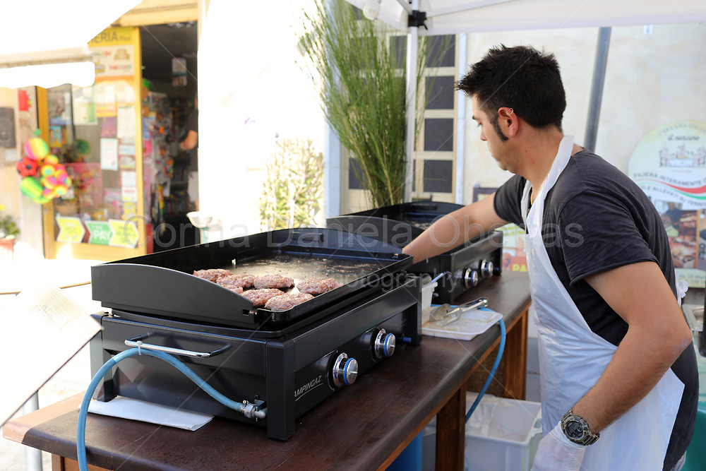 Cook in front of the grill.
