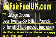 ©London News pictures. 10/03/11.Quentin Willson leads a Fuel Tax protest on College Green outside Parliament, holding a giant cheque to represent the £26 billion Britons pay in fuel duty each year, the campaign was organised by www.fairfueluk.com. Picture Credit should read Stephen Simpson/LNP