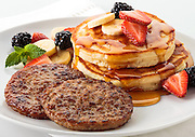 Maple sausage patties with pancakes and fresh fruit