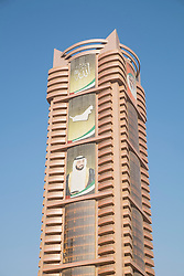 Detail of modern high-rise office building with picture of royalty in Ajman emirate in United Arab Emirates