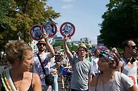DEU, Deutschland, Germany, Berlin, 27.07.2013:<br />StopWatchingUs-Solidaritätsdemonstration für den Whistleblower Edward Snowden und gegen die massenhafte Ausspähung von Kommunikationsdaten durch den US-Geheimdienst NSA. Teilnehmer mit selbstgebastelten Schildern, v.l.n.r.: Bundesinnenminister Hans-Peter Friedrich (CSU), Bundeskanzlerin Dr. Angela Merkel (CDU), Kanzleramtsminister Ronald Pofalla (CDU).