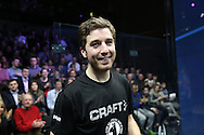Mathieu Castagnet of France (wearing Black shirt) smiles as he awaits to lift the Canary Wharf Trophy after his win. the Final, Omar Mosaad of Egypt v Mathieu Castagnet of France , Canary Wharf Squash Classic 2016 , at the East Wintergarden in Canary Wharf , London on Friday 11th March 2016.<br /> pic by John Patrick Fletcher, Andrew Orchard sports photography.