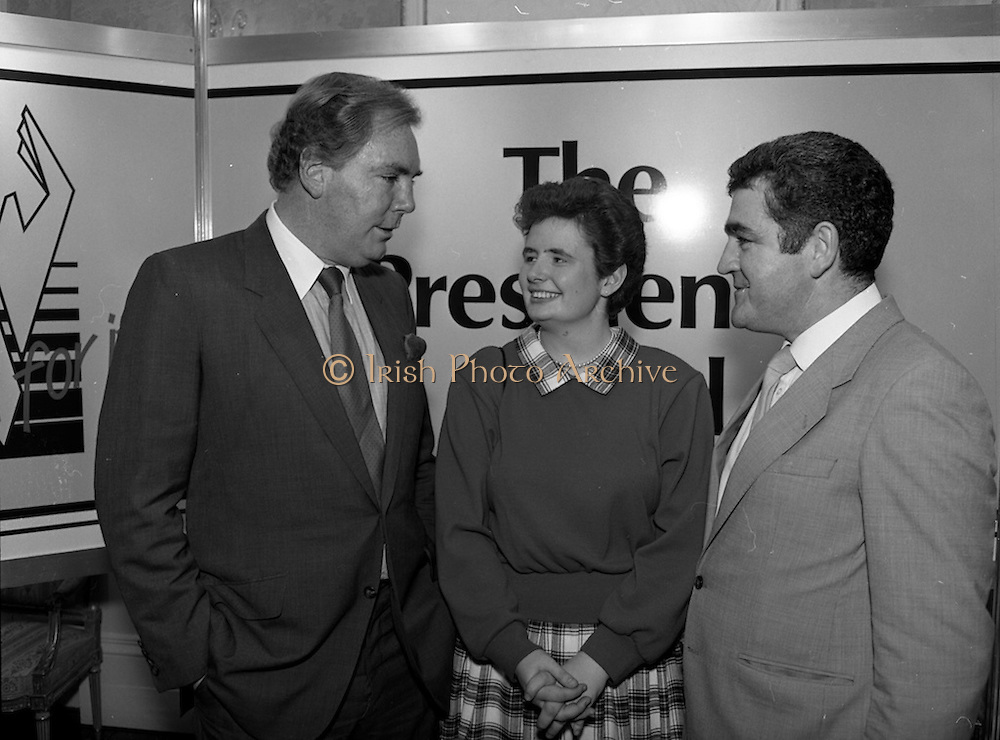 28/10/1985<br /> 10/28/1985<br /> 28 October 1985<br /> Launch of Gaisce The Presidents Award at Aras an Uachtarain. President Dr. Patrick Hillery launched the new national youth award scheme to be the nations highest award to Irish young people aged 15-25. Picture shows Dr. A.F.J. O'Reilly (left) Chairman of the Management Committee of the Award Scheme with Cathriona McSkeane (Ballybay, Co. Monaghan) and Mr. John Murphy, (right) Executive Director of the Award.