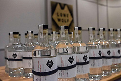 The eighth annual AGM of Scottish brewing firm, Brewdog, has been held in Aberdeen infant of 7,000 shareholders.<br /> <br /> Co-founders of the brewery James Watt and Martin Dickie launched a new gin and vodka line called Lonewolf. <br /> <br /> In addition a £100m funding package by US based TSG Consumer Partners saw the company now valued at £1bn<br /> <br /> Pictured: Bottles of Lonewolf gin launched at the AGM