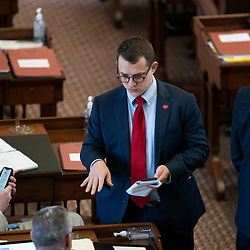 The Texas House debating SB 7 late into the night  a controversial omnibus elections bill that would make changes to the way Texas elections are held.  Rep. Briscoe Cain, R-Houston, looks for votes.