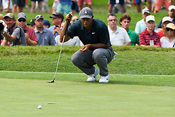 August 9, 2018 - St. Louis, Missouri, U.S. - Tiger Woods lines up a putt during the first round of the 100th PGA Championship at Bellerive Country Club. (Credit Image: © Debby Wong via ZUMA Wire)