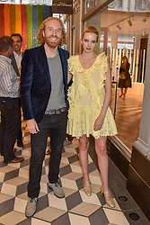 Oliver Wayman and Greta Bellamacina at a cocktail supper hosted by BOTTLETOP co-founders Cameron Saul & Oliver Wayman, along with Arizona Muse, Richard Curtis & Livia Firth to launch the #TOGETHERBAND campaign at The Quadrant Arcade on April 24, 2019 in London, England.<br /> <br /> ***For fees please contact us prior to publication***