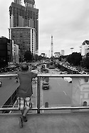 A man standing on the footbridge over Nguyen Chi Thanh Street watches the road work at Kim Ma junction, Ba Dinh District, Hanoi, Southeast Asia