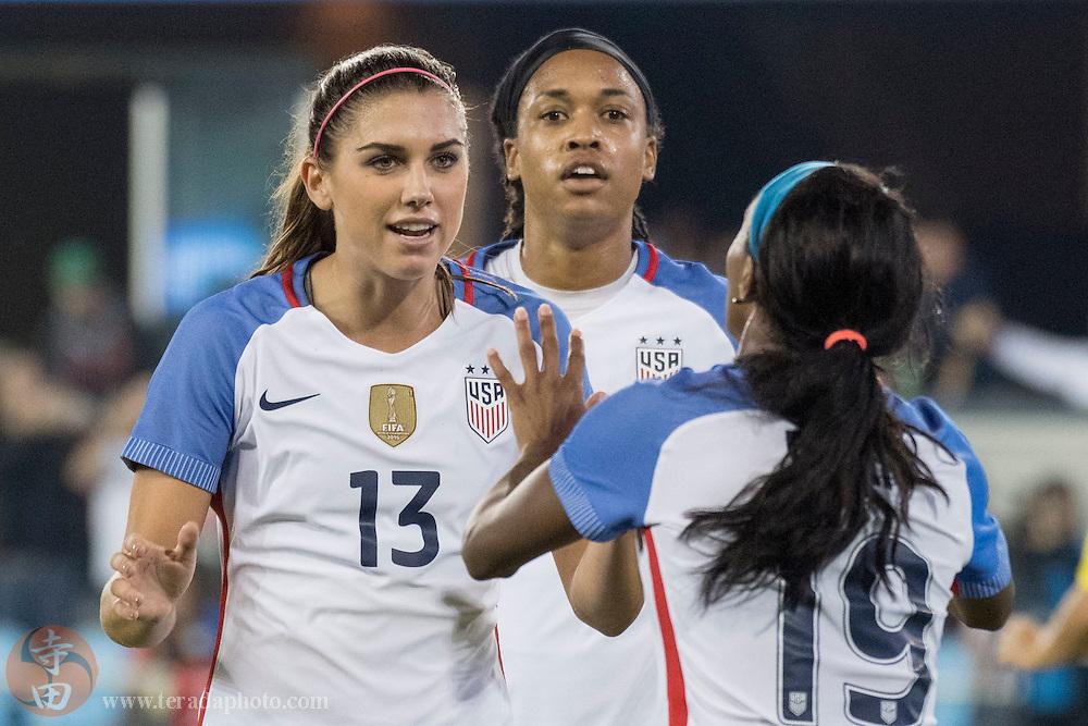 November 10, 2016; San Jose, CA, USA; Team USA forward Alex Morgan (13) is congratulated by forward Crystal Dunn (19) for scoring a goal against the Romania during the second half at Avaya Stadium. Team USA defeated Romania 8-1.