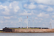View of historic Fort Sumter, where the Civil War began from the mouth of Charleston Harbor, South Carolina with Ravenel Bridge in the background.