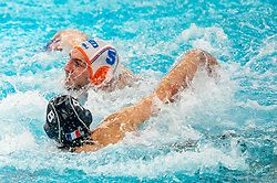 Guus van IJperen of the Netherlands in action against David Babicof France during the Olympic qualifying tournament. The Dutch water polo players are on the hunt for a starting ticket for the Olympic Games on February 17, 2021 in Rotterdam