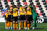 Newport County players get together before the EFL Sky Bet League 2 match between Newport County and Barrow at Rodney Parade, Newport, Wales on 19 September 2020.