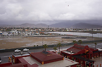 """(Image six of nine) Panorama of the Ensenada harbor in Mexico on a grey and raining day from the deck of the MV World Odyssey. The other cruse ship is the Carnival Imagination. Once all of the students, faculty, staff, and life long learners were aboard we would be ready to begin the 102 day """"round the world"""" Semester at Sea Spring 2016 Voyage. Composite of nine images taken with a Leica T camera and 23 mm f/2 lens (ISO 250, 23 mm, f/2, 1/80 sec). Panorama stitched using AutoPano Giga Pro."""