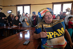 """""""Spam King"""" Paul Steele of Isleton, Calif. enjoys a cold beer at the 22nd annual Spam Festival, Sunday, Feb. 16, 2019, in Isleton. Spam lovers competed for prizes by presenting their favorite Spam-infused foods, or entering the Spam-eating and Spam-toss contests. (Photo by D. Ross Cameron)"""