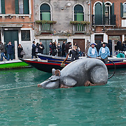 """VENICE, ITALY - FEBRUARY 20:  The """"Pantegana"""" (mouse) floats after launch along the Cannaregio Canal during the Venetian Feast on February 20, 2011 in Venice, Italy. During the Venetian Feast a traditional water parade sails from San Marco along the Canal Grande to the  district of Cannaregio where there the crowd waits for the Svolo della Pantegana (flight of the mouse)."""