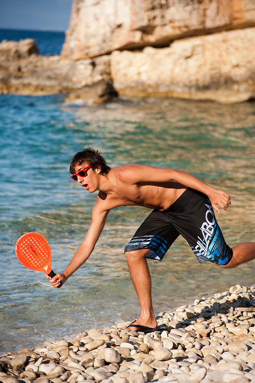 Francesco Martelli from Bologna Italy playing Beach racket Manadendri beach, Paxoi, Greece