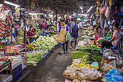 "03 OCTOBER 2012 - BANGKOK, THAILAND:    An aisle of produce in Khlong Toey Market. Khlong Toey (also called Khlong Toei) Market is one of the largest ""wet markets"" in Thailand. Thousands of people shop in the sprawling market for fresh fruits and vegetables as well meat, fish and poultry every day.       PHOTO BY JACK KURTZ"