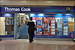 FILE PICTURE © Licensed to London News Pictures.  22/11/2011.AYLESBURY, UK. A general view, taken today (Tuesday), of the Thomas Cook travel agency branch in Aylesbury, Buckinghamshire. Thomas Cook Group plc issued a profits warning this morning and is to hold talks with its bankers about the groups financial position. The full year results are also likely to be delayed. The shares fell 70% in response and have lost over 90% of their value over the past year. Photo credit :  Cliff Hide/LNP