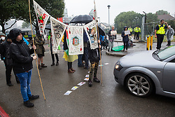 London, UK. 14th September, 2021. Stop The Arms Fair activists block the road outside ExCeL London on the first day of the DSEI 2021 arms fair. Activists from a range of different groups have been protesting outside the venue for one of the world's largest arms fairs for over a week.