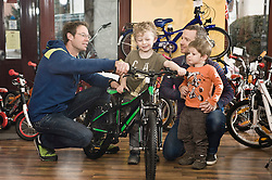 Boy getting a new children's bike