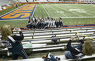 Cornwall varsity cheerleading coach Betty Bennett, left, and assistant Jennifer Roth take photographs of the Cornwall cheerleaders in the Carrier Dome stands during the Class D state championship game on Nov. 24, 2006, in Syracuse. The Class A game between Cornwall and Corning  East follows the D game.