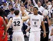 BYU guard Jimmer Fredette (32) and forward Brandon Davies (0) celebrate as fans cheer during the second half of an NCAA college basketball game against Arizona, Saturday Dec. 11, 2010 in Salt Lake City. Fredette scored 33 points in BYU's win 87-65 win. (AP Photo/Colin E Braley)