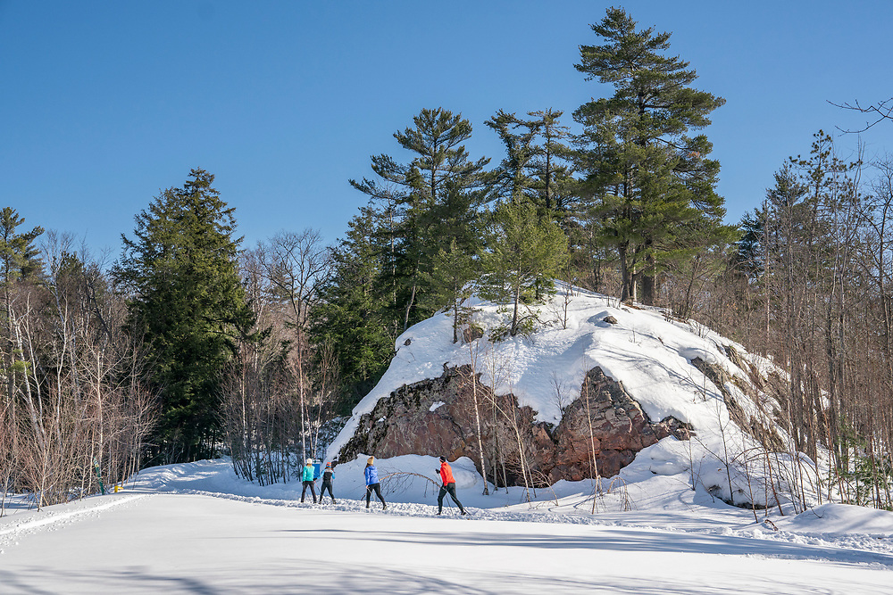 Family cross country skiing at Al Quaal Recreation Area in Ishpeming, Michigan.