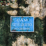 A no graffiti sign at the Imperial City in Hue, Vietnam. A self-enclosed and fortified palace, the complex includes the Purple Forbidden City, which was the inner sanctum of the imperial household, as well as temples, courtyards, gardens, and other buildings. Much of the Imperial City was damaged or destroyed during the Vietnam War. It is now designated as a UNESCO World Heritage site.