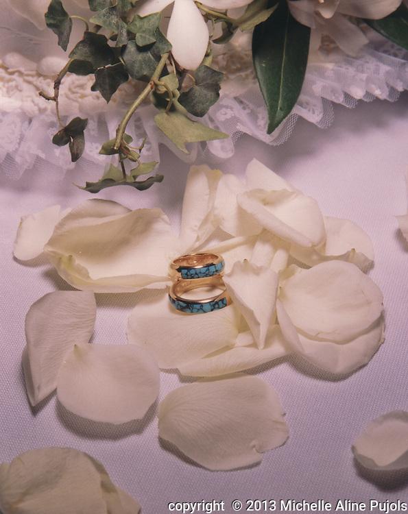 Inlaid wedding bands set in white rose peddles.