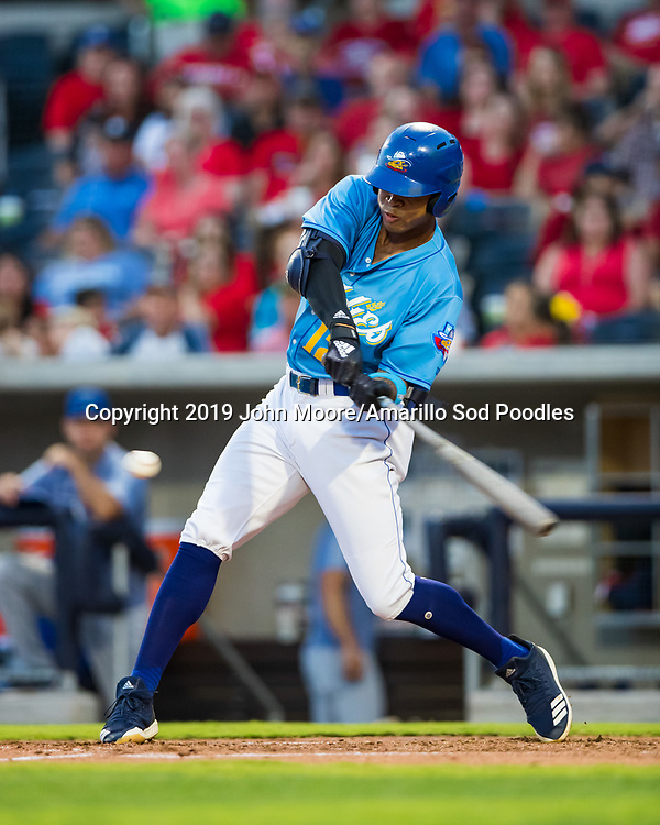 Amarillo Sod Poodles outfielder Buddy Reed (12) hits a home run against the Tulsa Drillers during the Texas League Championship on Tuesday, September 10, 2019, at HODGETOWN in Amarillo, Texas. [Photo by John Moore/Amarillo Sod Poodles]