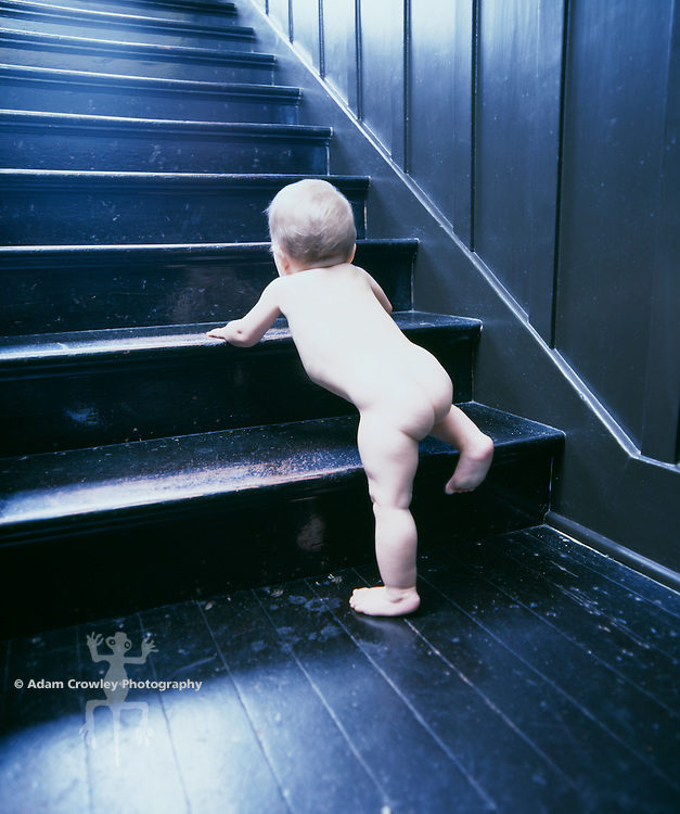 Baby (9-18 months old) crawling up stairs.