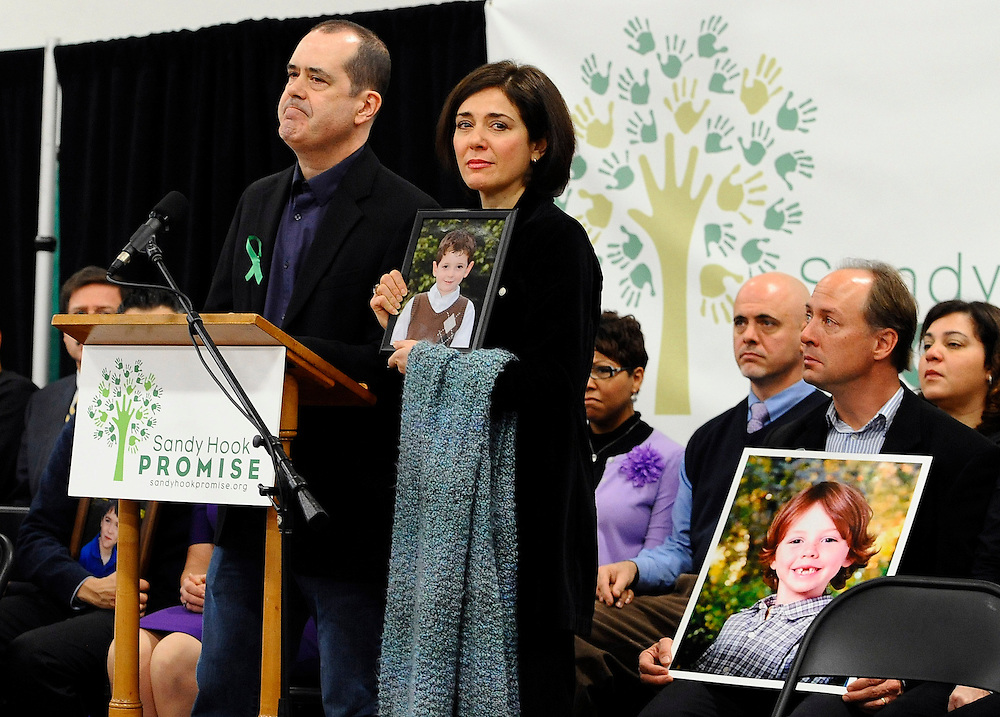 David and Francine Wheeler, parents of Sandy Hook School shooting victim Benjamin speak at a news conference at Edmond Town Hall in Newtown, Conn., Monday, Jan. 14, 2013. One month after the mass school shooting at Sandy Hook Elementary School, the parents joined a grassroots initiative called Sandy Hook Promise to support solutions for a safer community. (AP Photo/Jessica Hill)