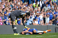Goalkeeper Petr Cech of Arsenal checks on Pedro of Chelsea after he kicks his face when they  collide. Barclays Premier League match, Chelsea v Arsenal at Stamford Bridge in London on Saturday 19th September 2015.<br /> pic by John Patrick Fletcher, Andrew Orchard sports photography.