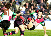 Twickenham. Surrey, UK., 23 February 2002, Zurich Premiership Rugby,  The Stoop Memorial Ground,   Quin's Dan Luger, is hit by Gloucester's, Diego Albanese, during the, NEC Harlequins vs Gloucester Rugby,<br /> [Mandatory Credit: Peter Spurrier/Intersport Images],