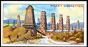 Nobel Brothers oil wells at Baku (Baky or Baki), Azerbaijan, on the Caspian Sea. From 'Mining' a set of cigarette cards published by WD & HO Wills, 1916.