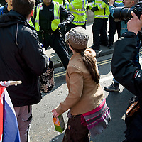 """London April 2nd 2009 (FILE IMAGE)  Picture shows an officer with his number hidden just seconds before allegedly swiping at the woman ( In the pic with cap) with the back of his hand and in the legs with the extendeble baton...***Standard Licence  Fee's Apply To All Image Use***.Marco Secchi /Xianpix. tel +44 (0) 845 050 6211. e-mail ms@msecchi.com or sales@xianpix.com.www.marcosecchi.com A police officer will be charged with assaulting a woman during the G20 demonstrations in London, the Crown Prosecution Service has said.Sergeant Delroy Smellie has been ordered to appear in court over the beating of Nicola Fisher.<br /> <br /> Prosecutors have decided there is """"sufficient evidence"""" for him to be charged."""