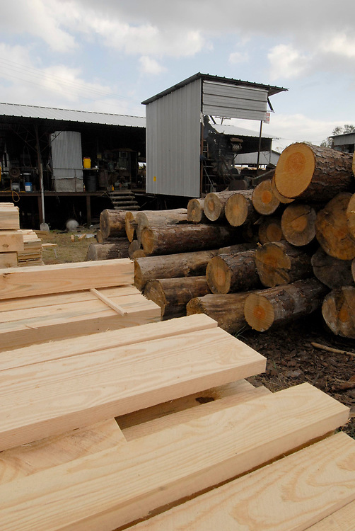 Orange, TX November 10, 2006: Raw and finished lumber at Rogers Lumber Company. Rogers Lumber Co processes pine lumber into rough-cut boards for the construction and trucking industries     ©Bob Daemmrich/