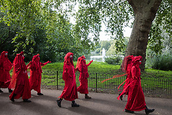Members of the Red Rebel Brigade walk towards St James's Park after leaving the Back The Bill rally by fellow climate activists from Extinction Rebellion in Parliament Square on 1st September 2020 in London, United Kingdom. Extinction Rebellion activists are attending a series of September Rebellion protests around the UK to call on politicians to back the Climate and Ecological Emergency Bill (CEE Bill) which requires, among other measures, a serious plan to deal with the UK's share of emissions and to halt critical rises in global temperatures and for ordinary people to be involved in future environmental planning by means of a Citizens' Assembly.